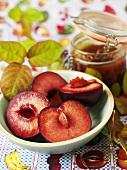 Halved plums and plum jam