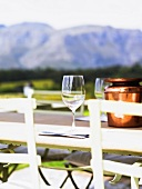 Glasses of wine on table, mountains in background