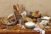 Still life with bread, bread rolls and baking ingredients