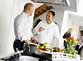 Two men chatting in kitchen