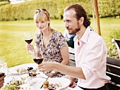 Couple eating in garden