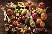 Exotic fruit on dark wooden background (still life)