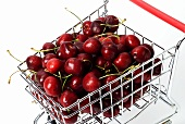 Toy shopping trolley full of cherries