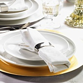 Festive place-setting with fabric napkin