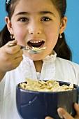 Girl eating cornflakes