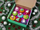 Assorted Christmas cupcakes in a box