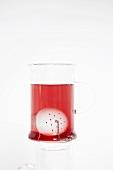 Fruit tea in glass with tea infuser