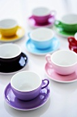 Several coloured coffee cups and saucers