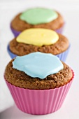 Three cupcakes with different coloured icing