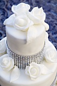 Wedding cake with rhinestones and white roses