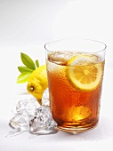 Glass of iced tea with lemon and ice cubes