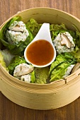 Steamed fish dumplings in bamboo basket (Asia)