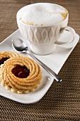Cappuccino and hazelnut & redcurrant jam tarts