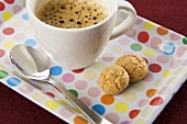 Espresso and amaretti on spotted tray
