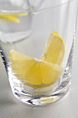 Glass of water with slices of lemon (close-up)