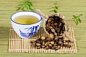 Cup of Notopterygium root tea (Qiang Hua, China)
