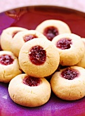 Jam biscuits on red plate
