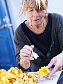 Woman cleaning chanterelles