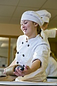 Young baker rolling out pastry