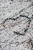 Heart made of pebbles on the beach