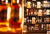 Shelf with various whiskeys with their designations of origin