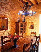 Rich oak furniture in dining room at Majorcan country house, Spain