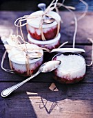 Rice pudding with strawberries in jars for a picnic