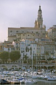 White church with yachts in harbour, Old Town of Menton