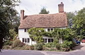 English house with red roof and chimney