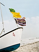 Shorts hanging on a line of sailing boat blowing in wind