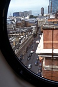 View of Great Eastern hotel and street through window, London