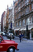 View of elegant facades of houses and pedestrians at Mayfair