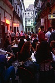 People sitting in cafe in city centre of Rio de Janeiro at dusk, Brazil