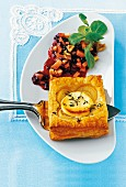 A puff pastry onion tart served with cranberry compote and thyme