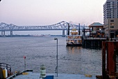 View of the Mississippi River with iron bridge in New Orleans