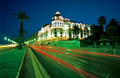 View of Negesco Hotel at night in Nice, France