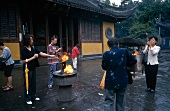 Believers performing rituals in front of Longhua Temple, Shanghai, China