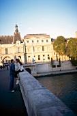 Couple kissing on bridge in Paris, France
