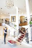 House keeper in Dorint Sofitel Maison Messmer, Baden-Baden, Germany, blurred motion