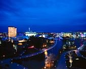 View of illuminated Autostadt museum at night, Wolfsburg, Germany