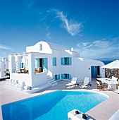 Holiday home with swimming pool, white and blue windows and doors, Santorini, Greece