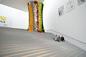 People sitting in Pinakothek der Moderne Museum in Munich, Germany