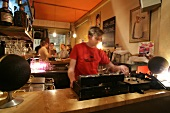 Disc jockey playing music in restaurant, Germany