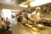 Chefs working in kitchen of restaurant in Netherlands