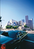 View of black limousine and Walt Disney Concert Hall in background at Los Angeles, USA