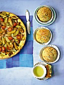 Potato tart with tomatoes and mushrooms served with potato rolls
