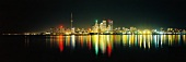 View of illuminated skyline with reflection in water at Toronto, Ontario, Canada