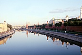 View of Moskva River with reflection of Moscow Kremlin in Moscow, Russia