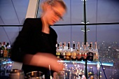 Waitress at bar counter of City Space Bar in Swissotel, Moscow, Russia, Blur