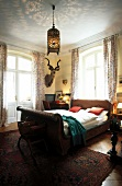 Bedroom with wicker bed and Antiquesin Villa Barleben, Germany